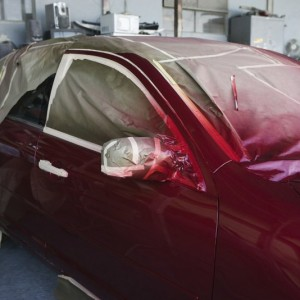 Image of a car getting painted in the shop at Custom Paint & Body in Charlotte NC